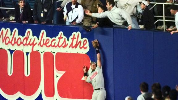Jeffrey Maier reaches over the wall to catch Jeter's homer