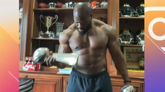 Harrison gets his pump on with Lombardi trophies