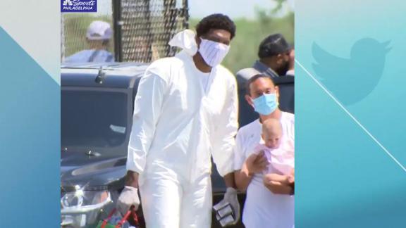 Embiid departs for NBA bubble in hazmat suit