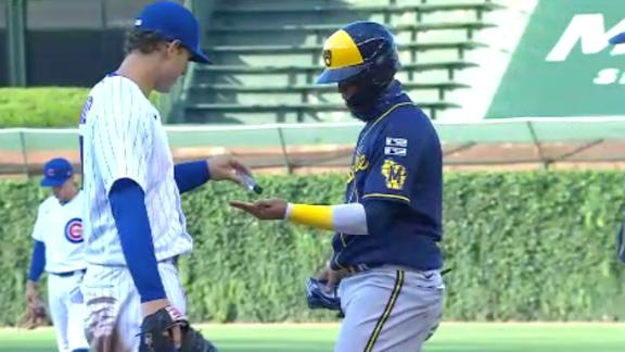Friendly sanitizer exchange occurs at first base between Rizzo, Arcia
