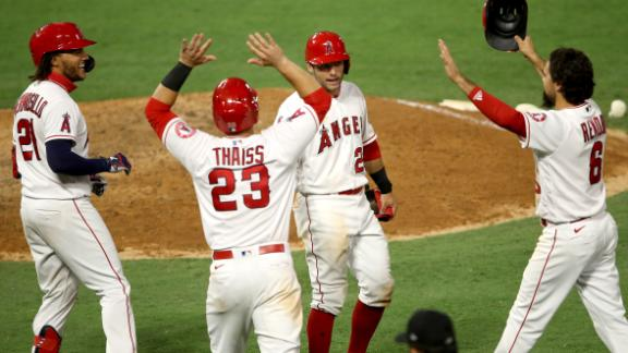 Angels fight off a late rally by the Astros to win in extras