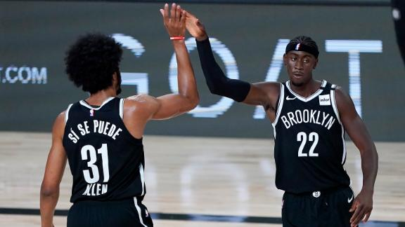Nets clinch playoff spot with win over Kings