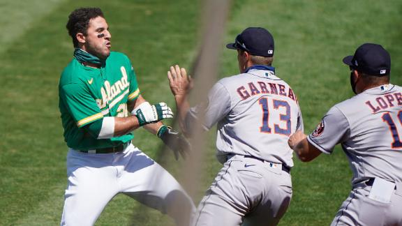 A's Laureano charges Astros dugout, fight ensues