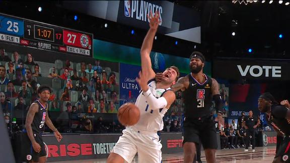 Morris ejected after hard foul on Doncic