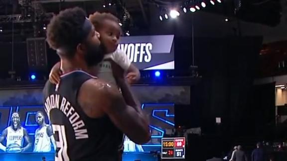Marcus Morris smooches up son at halftime