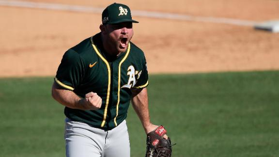 A's erase 3-run deficit, stave off elimination