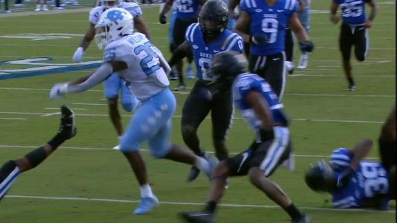 Williams bowls over a Duke defender for his fourth TD of game