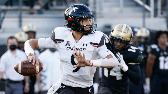 Ridder leads Bearcats with 4 TDs to remain undefeated