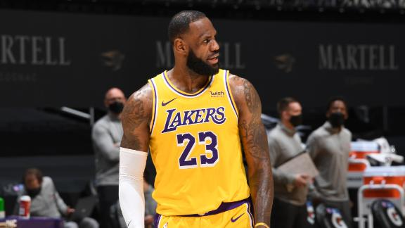 LeBron drains 2 clutch 3-pointers to seal Lakers' 2OT win