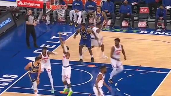 Curry's behind-the-back pass sets up Looney