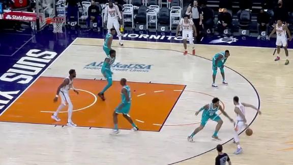 Booker's unbelievable behind-the-back dish to Ayton