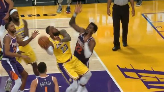LeBron flips in circus shot for and-1 bucket