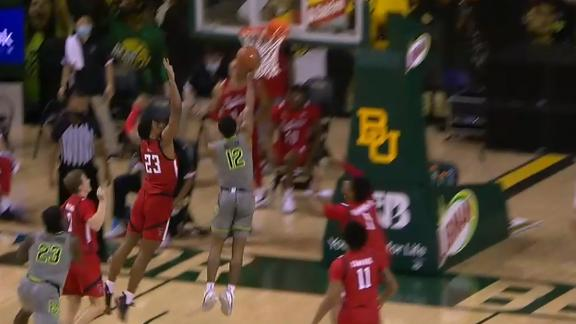 Butler spins and splits two Texas Tech defenders for the bucket
