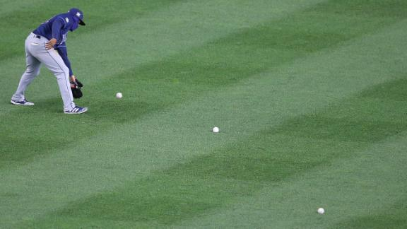 Yankees fans throw balls onto the field