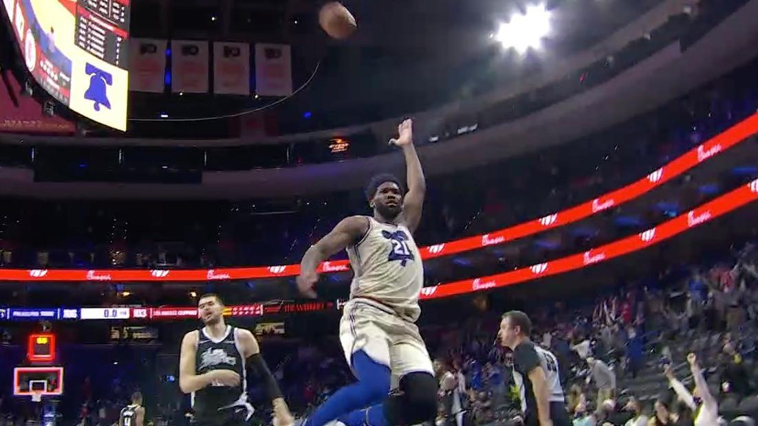 Embiid flips the ball over his head to celebrate win over Clippers