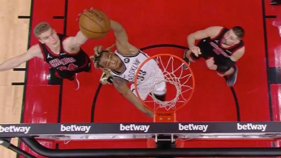 Claxton goes up with one hand for put-back slam