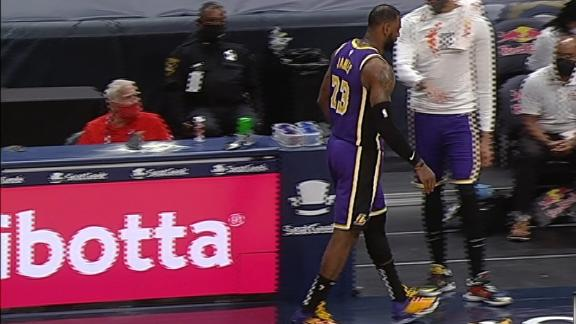 LeBron gingerly walks off the court after layup