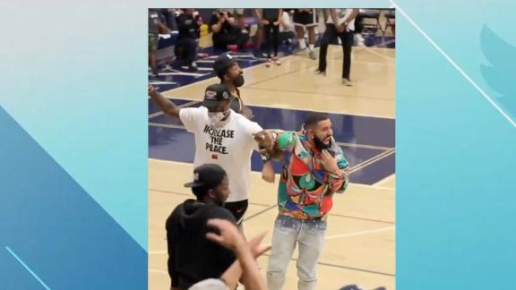 LeBron, Drake get out of their seats after a dunk from this UCLA commit