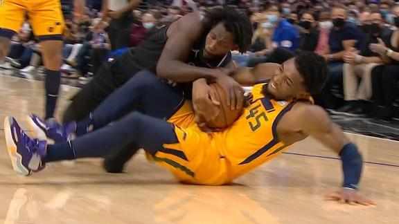 Pat Bev and Mitchell tussle over the loose ball