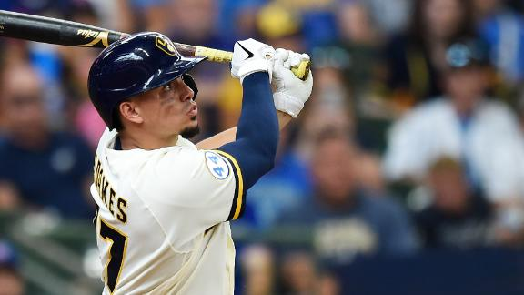 Brewers use eight-run fourth inning to take lead over Cubs