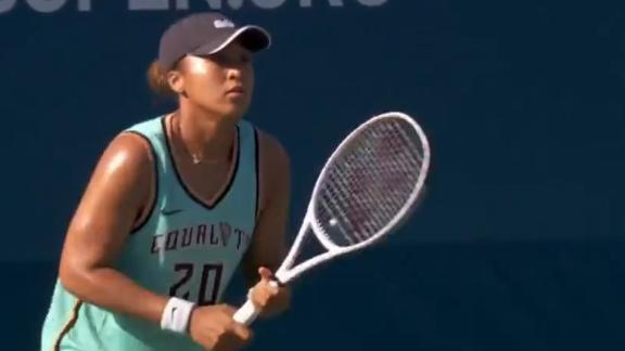 Naomi Osaka warms up in Sabrina Ionescu jersey