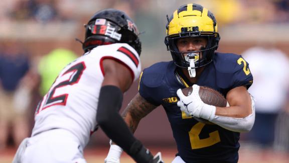 Michigan runs rampant with 8 rushing TDs in win