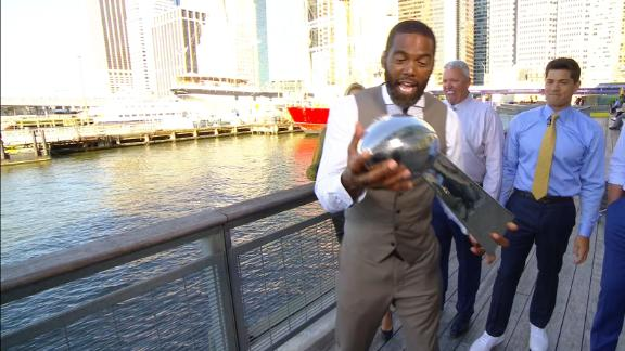 Randy Moss tries to see if Lombardi trophy will sink