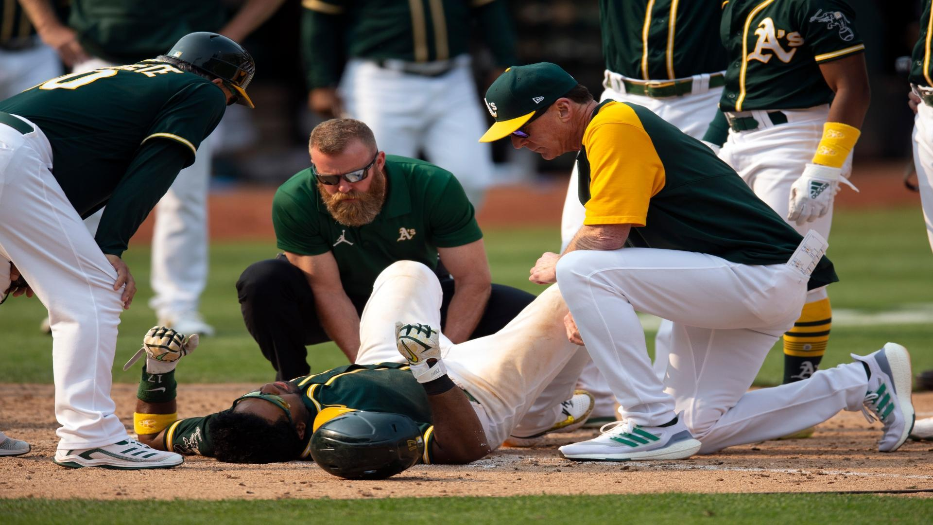 Elvis Andrus scores walk-off run for A's, suffers leg injury
