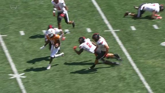 Texas' Xavier Worthy refuses to be tackled on 62-yard TD