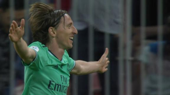 Modric stuns Valencia's defense with clever finish