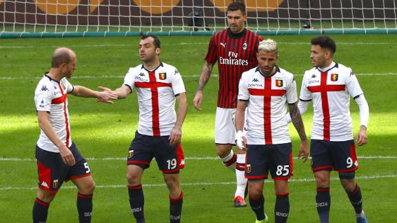 Genoa surprise Milan to escape relegation zone
