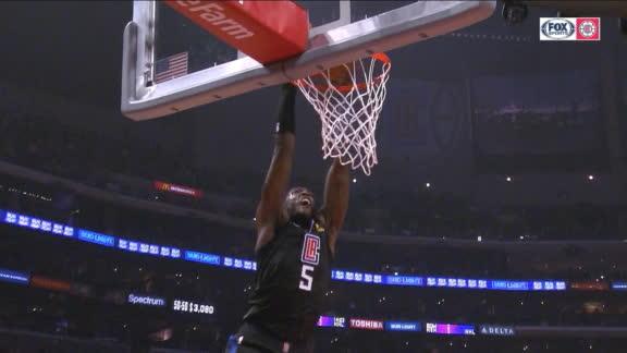 Harrell spins around defender, slams home big dunk