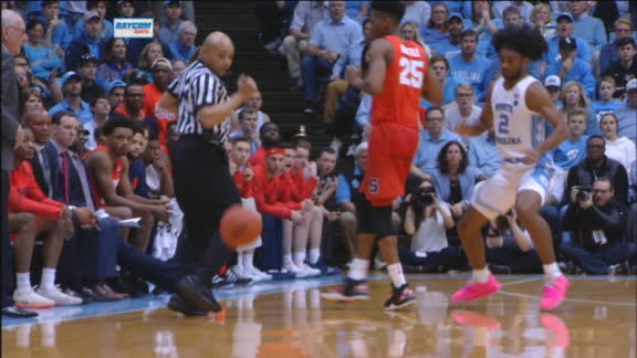 White receives unconventional assist from referee on jam