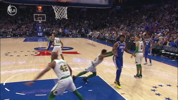 Embiid needs to be restrained after Smart shoves him