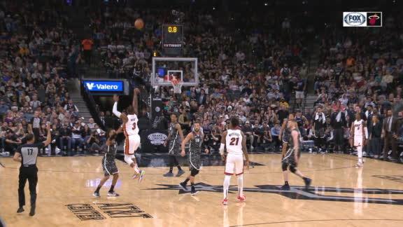 Wade sinks shot from beyond half court