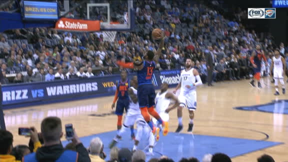 George slams home dunk after long pass from Adams