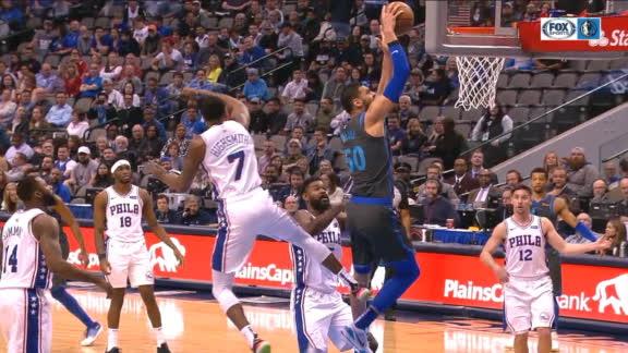 Mejri's dunk pumps up the Mavs' bench