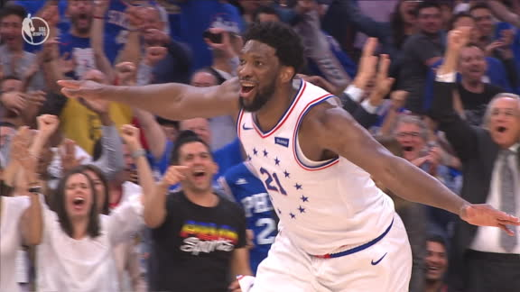 Embiid fires up crowd with windmill dunk