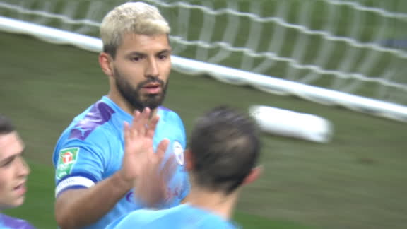 Aguero volleys home Man City's second