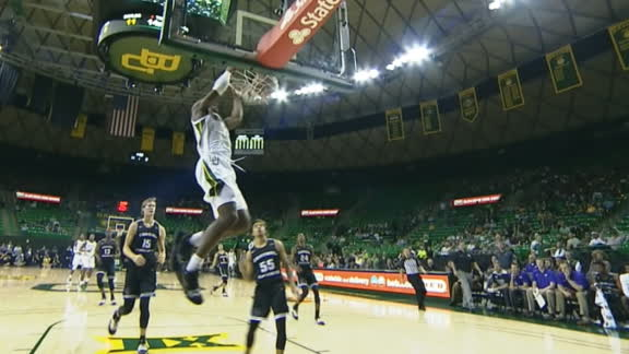 Baylor's Bandoo stuffs the rim with the 2-handed jam