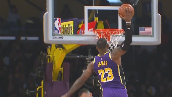 LeBron stares down Bjelica after posterizer