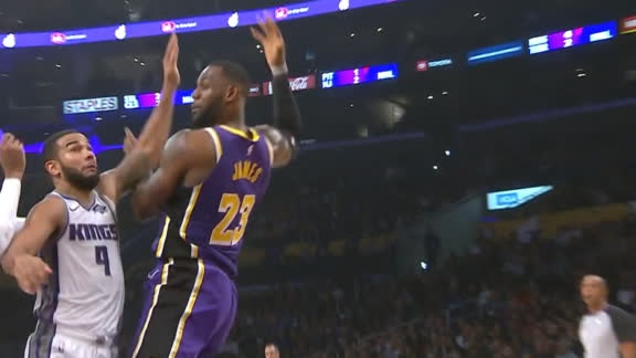 LeBron's slick pass finds McGee for dunk