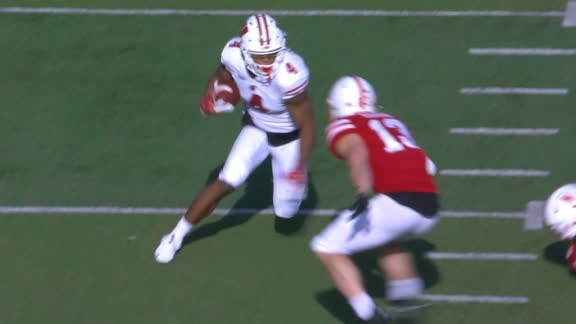 A.J. Taylor bounces off of tackles for another Badgers TD