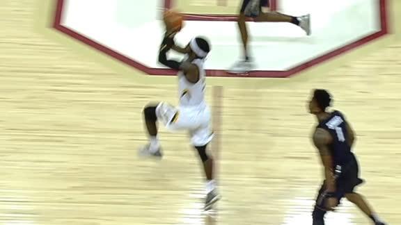 Towson's Dottin nails half-court shot at the buzzer