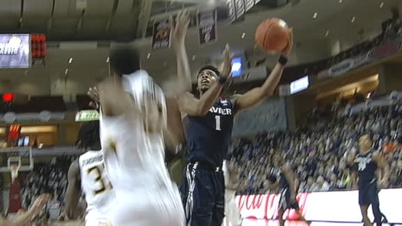 Xavier's Scruggs sends two Towson players flying with spin
