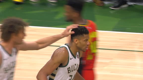 Giannis gets and-1 rebound off his own shot