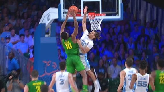 Anthony elevates to swat Juiston's dunk