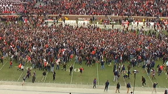 Virginia fans rush the field after defeating VA Tech