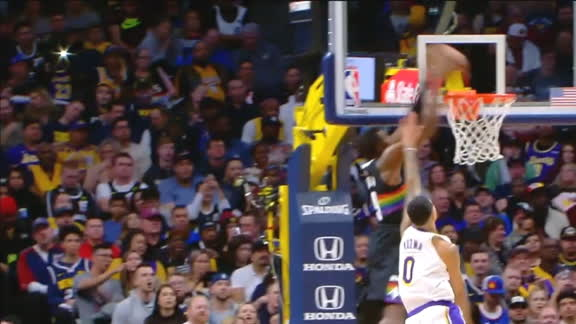 Grant hammers home alley-oop dunk
