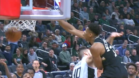 Giannis enjoying his birthday by posterizing Zubac